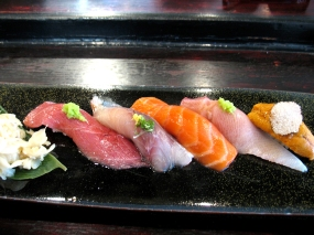 Things come to a close with a nigiri sushi platter: bluefin toro; aji (Spanish mackerel); wild ocean trout from New Zealand; hamachi (yellowtail) belly; Santa Barbara uni with a dab of truffle butter melted on top, dusted with truffle salt and then garnished with a thin slice of black truffle. Freshly grated wasabi on the toro and hamachi; freshly grated ginger on the aji; smoked soy sauce on the trout. The toro and trout were very, very good; the uni was as decadent as you would expect; the hamachi belly and aji were just okay.