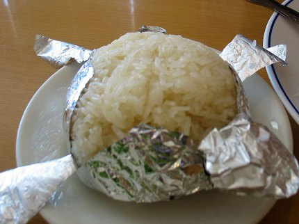 Sticky Rice. This was a waste of space. The rice was more hard than sticky and as it had been cooked in a ball of aluminum foil it was a pain in the ass separating the foil from the rice.