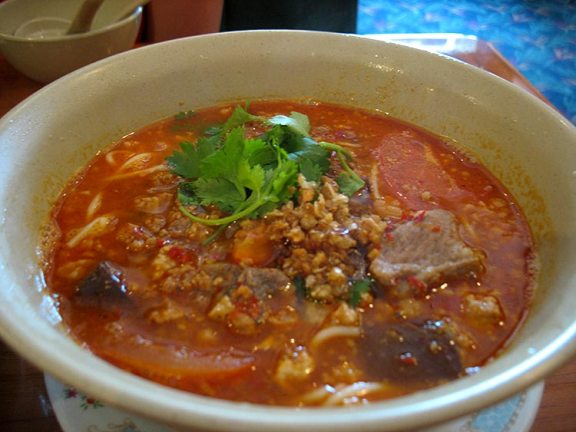 Nam Ngeao also features rice noodles (though thinner tubular noodles unlike the broader flat noodles in the Kao Soy) floating in a tangy and spicy soupy red curry; this is made without coconut cream/milk. We got it with sliced pork ribs but there were also lots of cubes of congealed pig blood floating in it. This may or may not sound appealing, but if not, imagine far less gamy and chewy chunks of liver and you're pretty much there. This was also very, very good. More acidic and tangy than the Kao Soy and a bit spicier too.