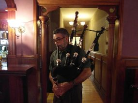 Dennis on the bagpipes