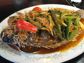 Pla-Lad Prik: A deep-fried whole Tilapia with thick red curry poured over it. The fish was perfectly cooked and the curry, thick with coconut cream and redolent of green peppercorn and lime leaf, was wonderful. We've had a number of these whole fish dishes and they're all excellent. I particularly recommend the crispy one with three-flavours sauce and the steamed fish with lime and chillies.
