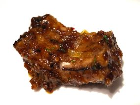 meetha achar chilean spare ribs, sundried mango, toasted kalonji seeds
