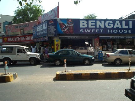 Bengali Sweets, exterior. We ate there on this trip, but from the lack of a dull haze in this photograph you may be able to tell that it was taken in the summer (of 2005, to be exact).