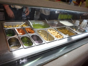 This is a more modern assembly line-style counter at one of the outposts of Haldiram's, the first major chain to take chaat upscale in the new India. Unfortunately, Haldiram's appeal was always in its novelty rather than its flavour and I'm not a fan. Still, one eats chaat where one can and we were right next to this place for some shopping.