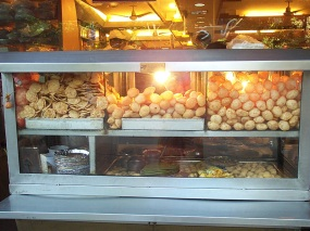 This picture, taken in 2005, is of the outdoor gol-gappa counter at one of the outposts of Nathu's, which is one of the venerable sit-down chaat and snack houses in New Delhi.