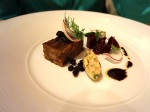 Oxtail terrine with roasted beets, smoked bone marrow, shaved radish and currants.