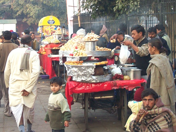 This picture was taken in 2003 and shows a street chaat vendor outside the Red Fort in New Delhi. This kind of informal establishment is still the major mode of chaat delivery in North India
