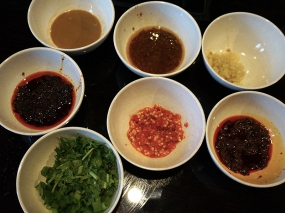 Condiments. Everything is labelled clearly at the station so there's no risk of confusion. Here we have a couple of types of chilli sauce, chilli paste, barbecue sauce, sesame paste, cilantro/green onions and crushed garlic.