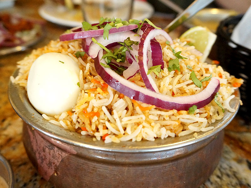 "This is the Hyderabadi Chicken Dum Biryani. Given the presence of the word ""biryani"" in the group's name I had high hopes for this but it was just so-so. Now, it may well be the best biryani in the region as one person on Chowhound described it, but that's not saying much in and of itself. The rice was too soft and didn't really have the aroma/flavour of the chicken bound to it."