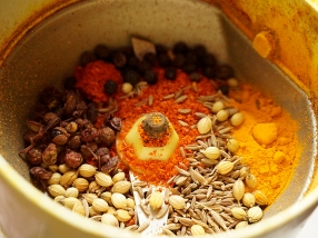 The spices for the sauce about to be ground.