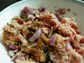 Ground spices, chopped onion, salt and crumbled kasoori methi added to the meat.