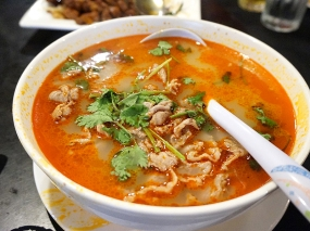 """Less mild but just as good is this """"Lamb in Spicy Soup"""". Thinly sliced lamb in a (not terribly) spicy and tangy/sour broth."""