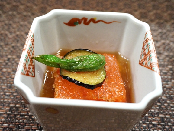 "Their famous agedashi tomato ""tofu"". There's no tofu here, only compressed tomato (I would guess tomato water bound by agar etc.) in a lovely dashi. I was looking forward to this and it did not disappoint---one of the highlights of the meal for me. Culinary trickery aside, this was delicious and heartwarming."