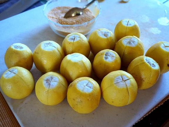 Lemons, thoroughly dried, slit and ready to be stuffed.