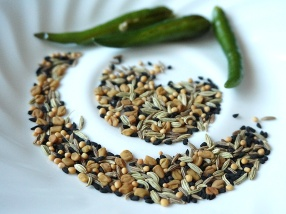 A lot of people use only kalonji (nigella seeds); my stock was very old and so I went with panch phoron.