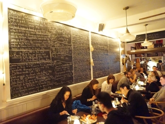 The menus on the wall of the main dining room. Alas, our table was in a far darker part of the room.