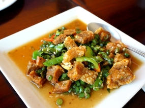 Their signature crispy pork over basil leaves and other veg.