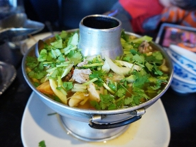 Sour soup with tripe and other offally bits. Earthier than the related tom yum and quite a nice change-up. We got this at the first meal.