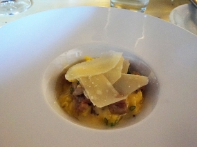 Scrambled brown eggs with pickled pig's feet, truffle butter and parmigiano-reggiano