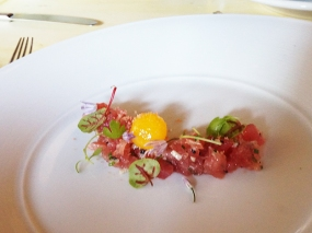 Tuna crudo with cured egg yolk, mojama, summer truffles and petite herbs