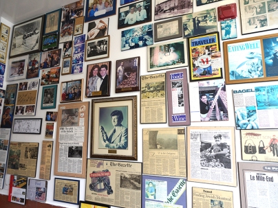 Two of the walls of the shop are covered with images and clippings commemorating the store's history.