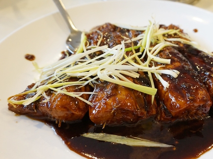 The braised fish tail, on the other hand, pleased everyone. The fish was cooked perfectly and if the brown, almost syrupy sauce tipped over into being cloying, the ginger and scallions pulled it back.