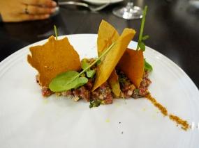 Bison Tartare: harissa aïoli, socca chips, cilantro