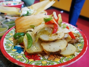 A side of potatoes and peppers and onions. Very nice but really calling out for some fried eggs and chorizo.