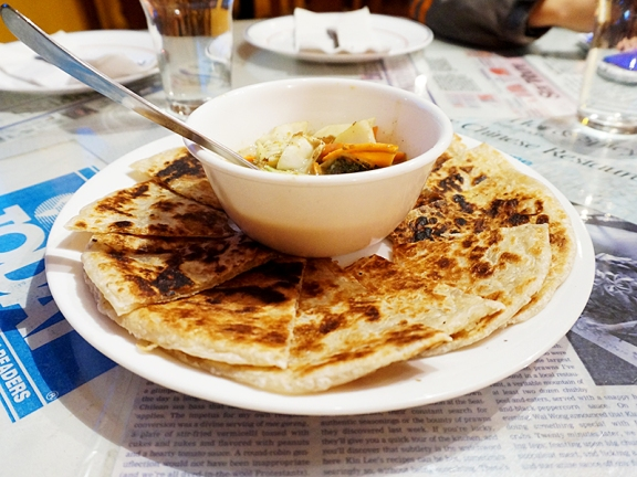 The curry was unlike any we'd ever been served with roti-prata---whether in Singapore (the city) or elsewhere in the US but the paratha itself was fine.