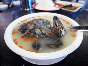 Maybe another hard sell on account of the black chicken (all of which is in the bowl)? Anyway, don't let that deter you: it tastes just like regular chicken and the mild broth is wonderful. The orange things are wolfberries, we were told.