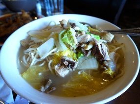 """This is from their """"Szechuan Noodles"""" menu. A chicken with bone and skin in a very comforting broth with noodles and napa cabbage."""