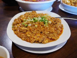 "Okay, this may be a harder sell for most but this is really very good. Scrambled pork brains in a hot and numbing sauce. Kang had the kitchen make it extra hot for us to ""bring the flavour out"". If you've not had brains think softer but much milder liver. Try it but maybe also get it in a group of six people; for even if you like brains there's a limit to how much brains two people can eat (even on Halloween weekend)."