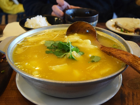 This soup, which can be gotten spicy or non-spicy, shows up in two sections on the menu. The colour is from pumpkin, I believe, which also gives it a mild sweetness. It's hard to describe: think the velvety texture of the best corn soup and the sourness of the best hot and sour soup. Slices of perfectly poached fish in the soup and shreds of enoki mushrooms floating on top. I loved it.