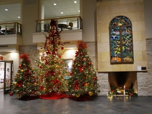Christmas trees and decorations in the lobby of Buntrock Commons.