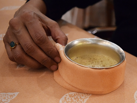 South Indian-style filter coffee. A huge production was made of cooling it down by pouring it back and forth from the metal pot it came in to the bowl in which it was served (the napkin is wrapped around to serve as a handle).