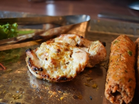 Closeup of the malai tikkas, which were also very good, expertly marinated and grilled.