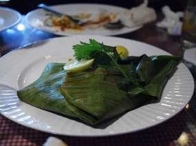 A classic Parsi dish of fish (machhi) coated with spices and steamed in a banana leaf (patra).