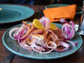 Thinly sliced onions with lime and chaat masala.