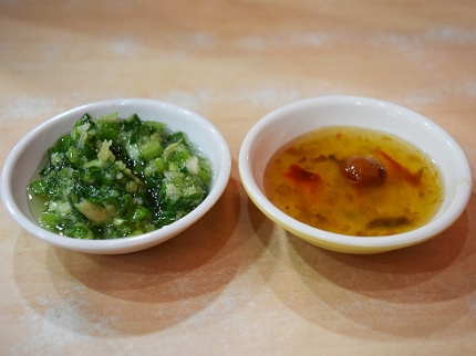 The green sauce (scallion and ginger) was for the chicken and the other (plum and chilli) was for the goose.