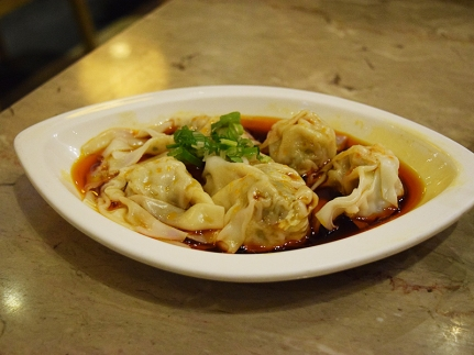 Sichuan-style spicy wontons with more of a vinegary kick in the dressing than we're used to. Very good.