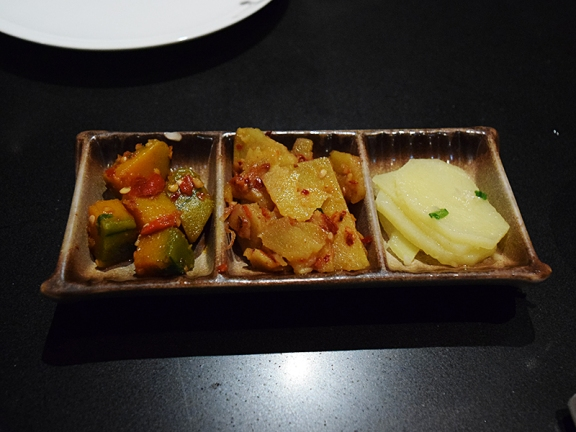 As you sit down they place a little trio of seasoned veg on the table.