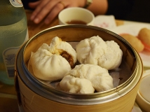 "Well, the proper name is ""Steamed Honey Glazed BBQ Pork Buns with Saucy Filling"". This is another dish I don't order anymore at most places in the US as you usually get a dry shell with a cloying interior. But as with the beef balls I wanted to see what it was like here and, again, it was very good. But not any better than the best versions in the SGV probably."
