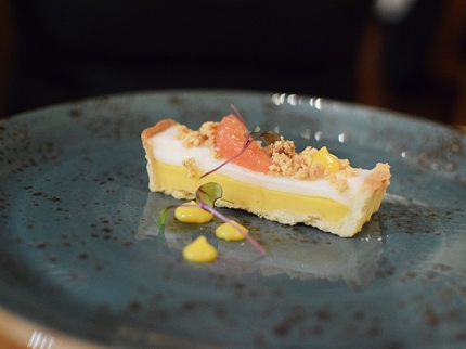 Grapefruit tart with meringue, cashew streusel, and grapefruit curd