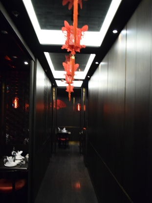 You go down a long hallway with dining rooms opening on the side. The red lamps were for the then impending Lunar New Year.