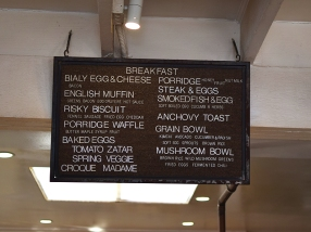 Above it are signboards that list dishes but not prices (never a good sign for those who worry about prices). This one lists some of their breakfast selections.