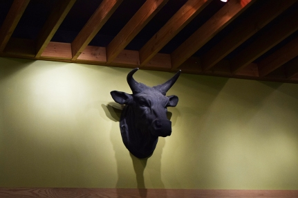 At some point you will notice the bull staring balefully at you from the wall opposite the one with the sake bottles and your thoughts will turn to meat.
