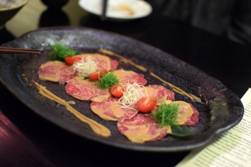 Thin discs of raw wagyu with shredded scallions and radish and a killer pepper sauce. Great stuff.