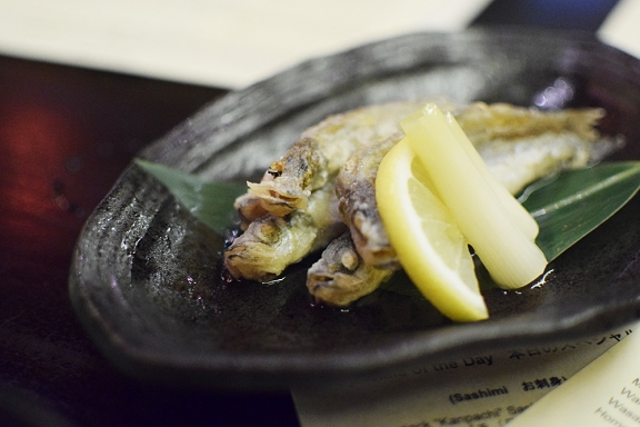 You eat all of each tiny fish, ideally in no more than two bites. And don't forget to eat the pickled scallion too!