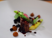 Piccolo: Peterson Farms skirt steak with caramelized onion romesco, jumbo asparagus, and black fig jus