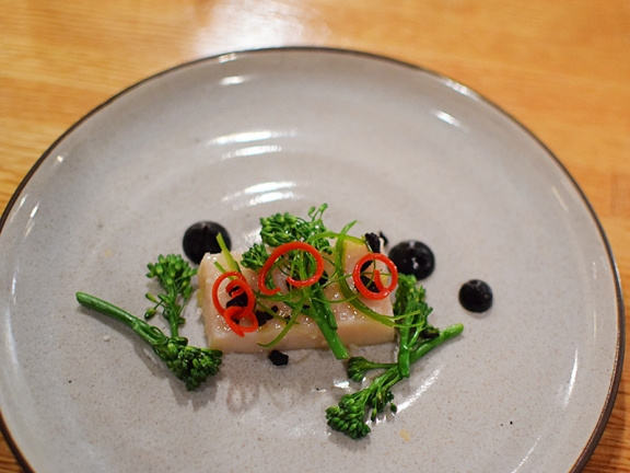 Piccolo: Olive oil poached swordfish belly with black olive, broccolini, and fresno peppers
